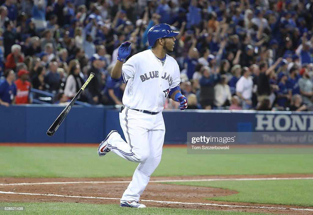 <a gi-track='captionPersonalityLinkClicked' href=/galleries/search?phrase=Edwin+Encarnacion&family=editorial&specificpeople=598285 ng-click='$event.stopPropagation()'>Edwin Encarnacion</a> #10 of the Toronto Blue Jays tosses aside his bat after hitting a three-run home run in the second inning during MLB game action against the Texas Rangers on May 5, 2016 at Rogers Centre in Toronto, Ontario, Canada.