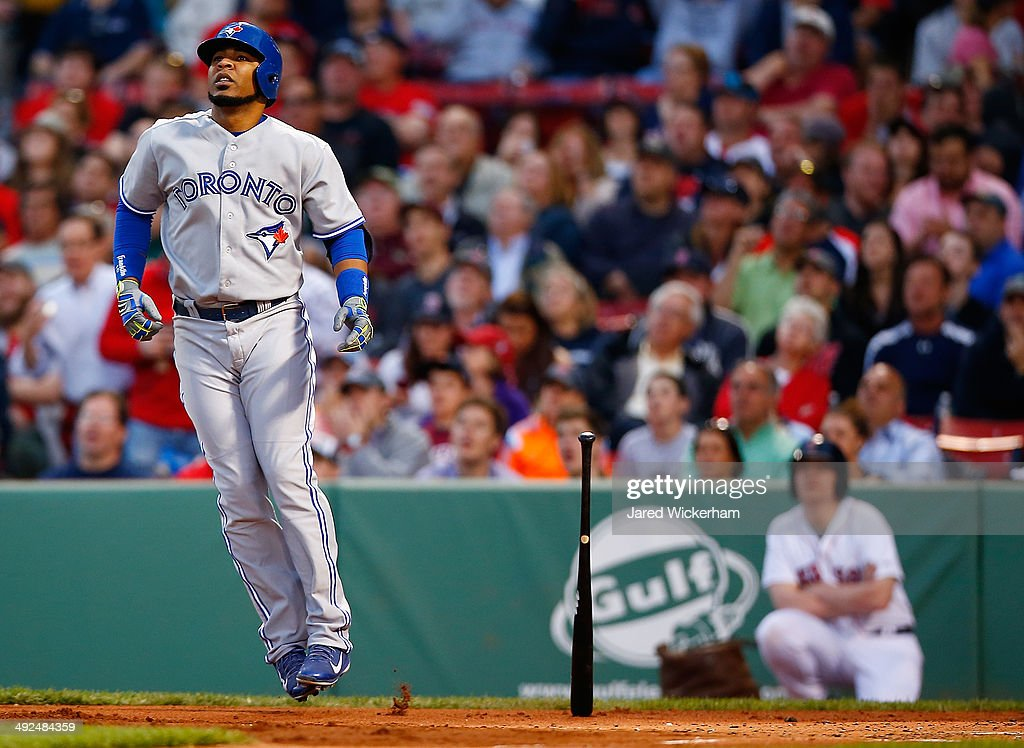 <a gi-track='captionPersonalityLinkClicked' href=/galleries/search?phrase=Edwin+Encarnacion&family=editorial&specificpeople=598285 ng-click='$event.stopPropagation()'>Edwin Encarnacion</a> #10 of the Toronto Blue Jays watches the ball after hitting a two-run home run in the third inning against the Boston Red Sox during the game at Fenway Park on May 20, 2014 in Boston, Massachusetts.