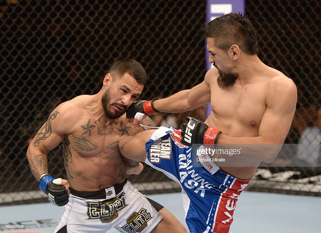 Edwin Figueroa kicks Francisco Rivera during their bantamweight fight at UFC 156 on February 2, 2013 at the Mandalay Bay Events Center in Las Vegas, Nevada.