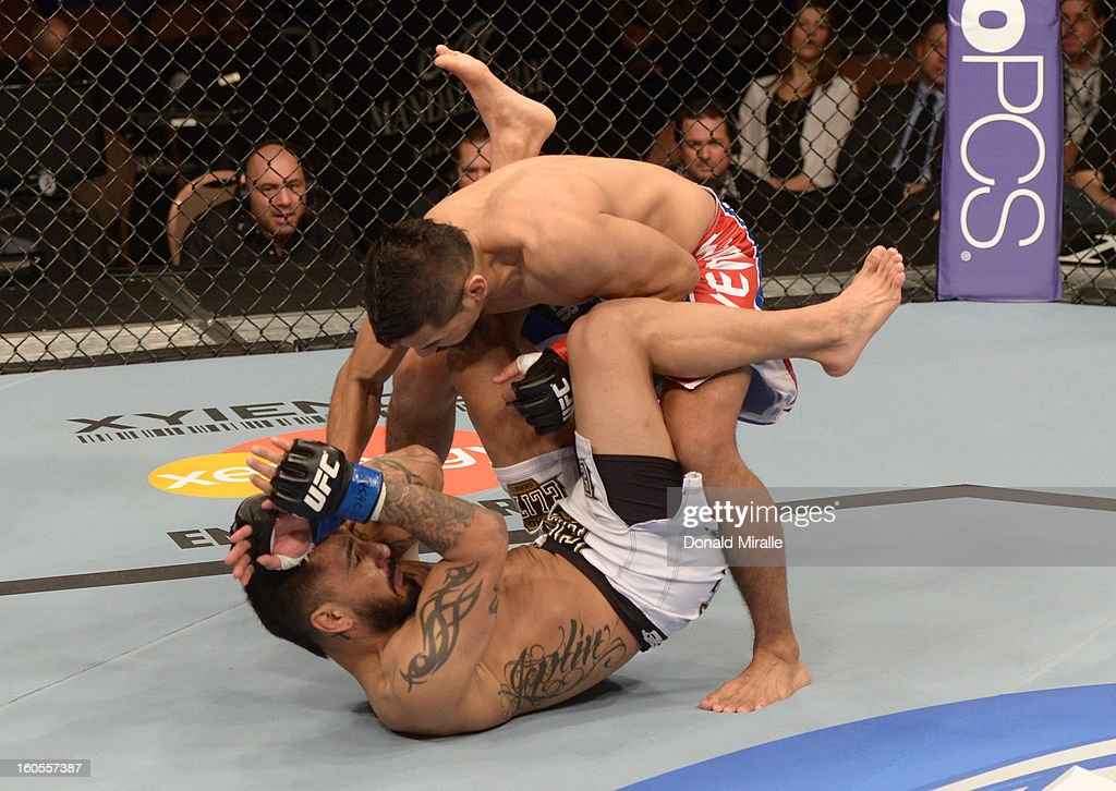 Edwin Figueroa (top) punches Francisco Rivera during their bantamweight fight at UFC 156 on February 2, 2013 at the Mandalay Bay Events Center in Las Vegas, Nevada.