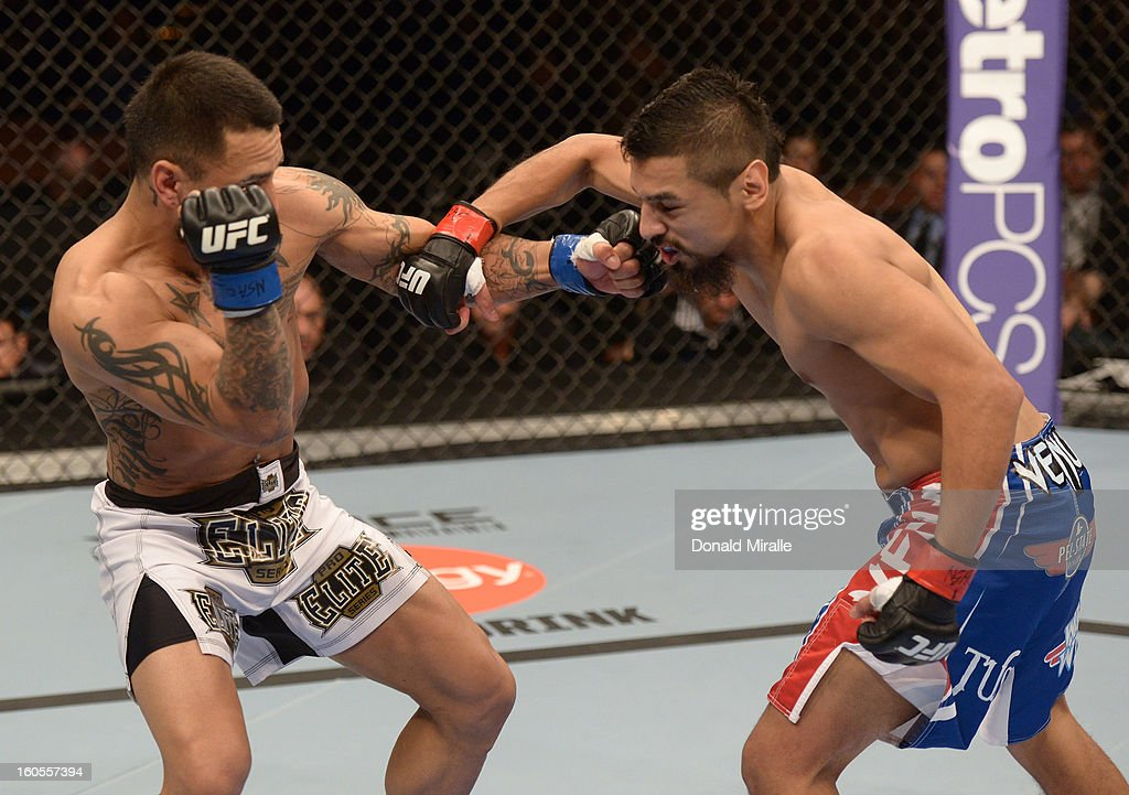 Edwin Figueroa punches Francisco Rivera during their bantamweight fight at UFC 156 on February 2, 2013 at the Mandalay Bay Events Center in Las Vegas, Nevada.