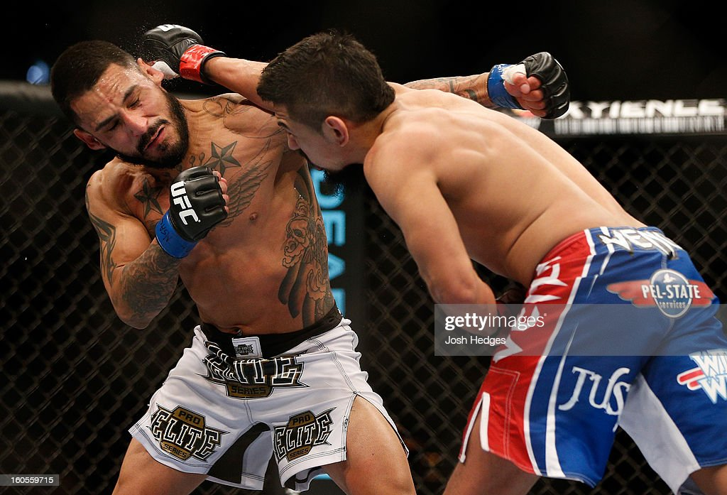 Edwin Figueroa (right) punches Francisco Rivera during their bantamweight fight at UFC 156 on February 2, 2013 at the Mandalay Bay Events Center in Las Vegas, Nevada.