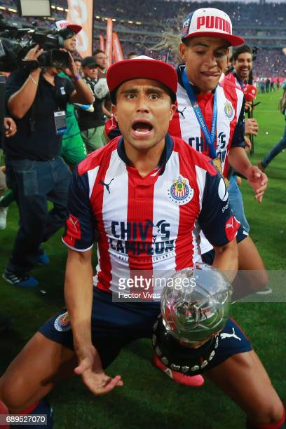 Edwin Hernandez of Chivas celebrates with the champions trophy after the Final second leg match between Chivas and Tigres UANL as part of the Torneo...