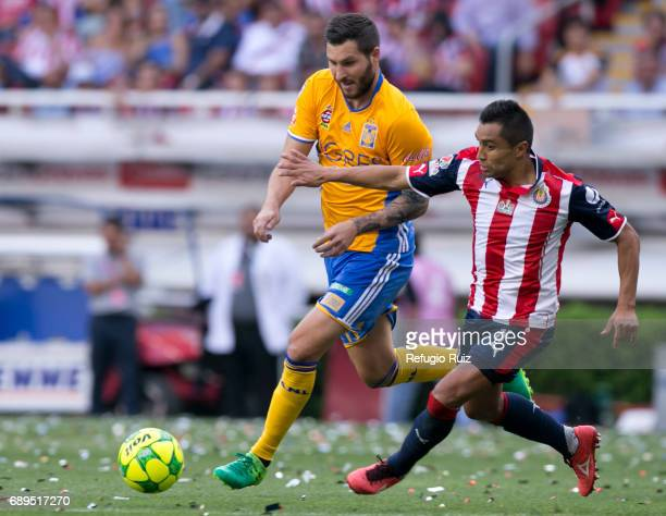 Edwin Hernandez of Chivas fights for the ball with Andre Pierre Gignac of Tigres during the Final second leg match between Chivas and Tigres UANL as...