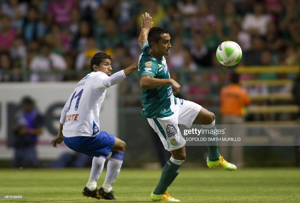 Edwin Hernandez of Leon vies for the ball with Joao Rojas of Cruz Azul during the first leg quarterfinal of the Mexican Clausura tournament football...