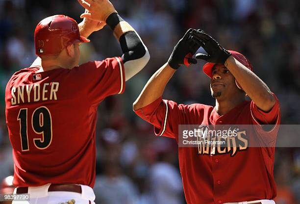 Edwin Jackson of the Arizona Diamondbacks is congratulated by teammate Chris Snyder after Jackson hit a 2 run home run against the Pittsburgh Pirates...