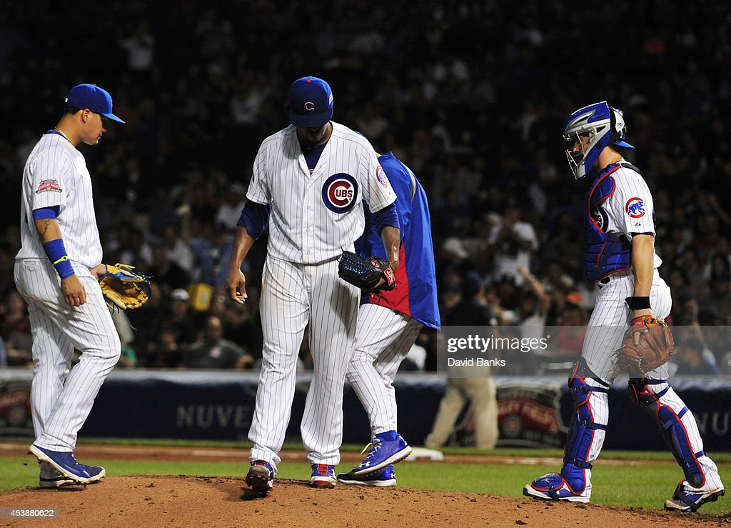 <a gi-track='captionPersonalityLinkClicked' href=/galleries/search?phrase=Edwin+Jackson&family=editorial&specificpeople=220506 ng-click='$event.stopPropagation()'>Edwin Jackson</a> #36 of the Chicago Cubs leaves the game against the San Francisco Giants during the third inning on August 20, 2014 at Wrigley Field in Chicago, Illinois.