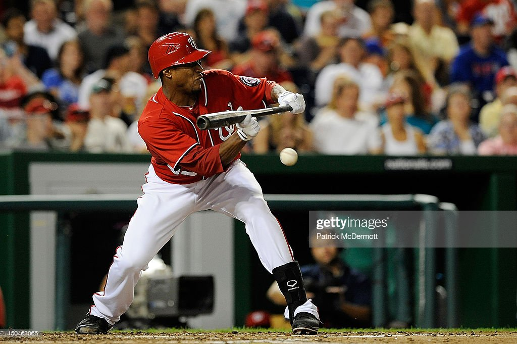<a gi-track='captionPersonalityLinkClicked' href=/galleries/search?phrase=Edwin+Jackson&family=editorial&specificpeople=220506 ng-click='$event.stopPropagation()'>Edwin Jackson</a> #33 of the Washington Nationals hits a sacrifice bunt in the fifth inning against the New York Mets at Nationals Park on August 18, 2012 in Washington, DC.