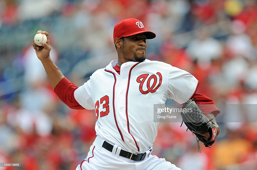 <a gi-track='captionPersonalityLinkClicked' href=/galleries/search?phrase=Edwin+Jackson&family=editorial&specificpeople=220506 ng-click='$event.stopPropagation()'>Edwin Jackson</a> #33 of the Washington Nationals pitches against the Philadelphia Phillies at Nationals Park on October 3, 2012 in Washington, DC.