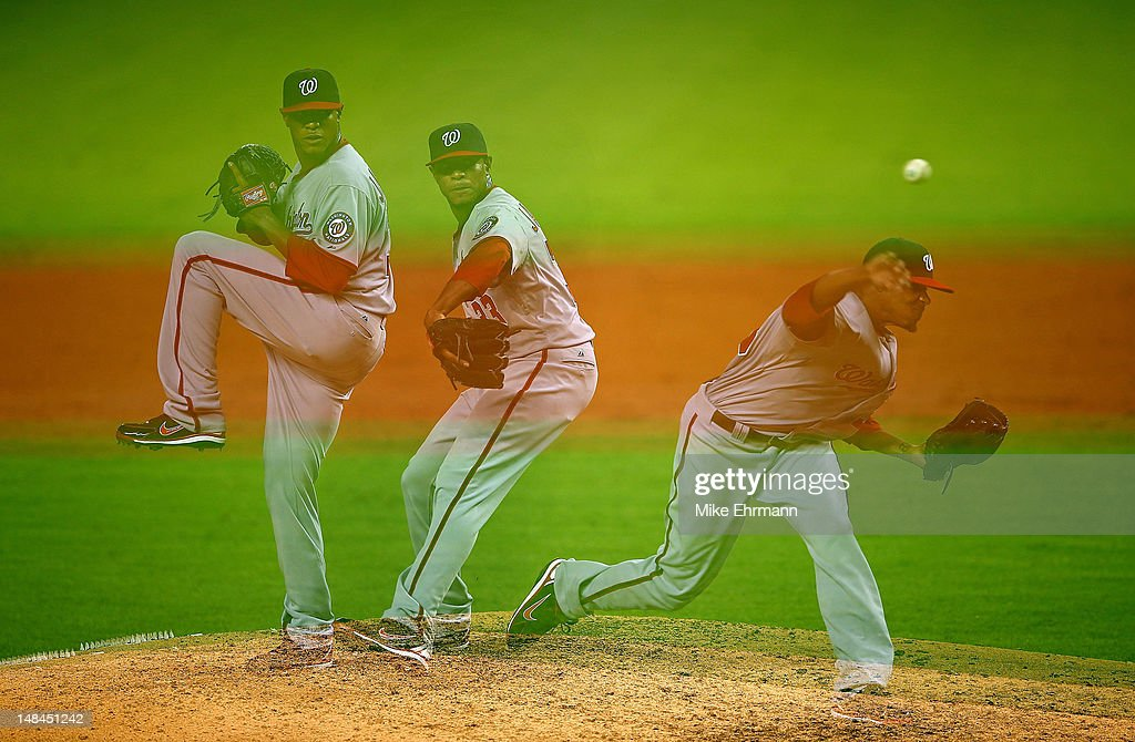 <a gi-track='captionPersonalityLinkClicked' href=/galleries/search?phrase=Edwin+Jackson&family=editorial&specificpeople=220506 ng-click='$event.stopPropagation()'>Edwin Jackson</a> #33 of the Washington Nationals pitches during a game against the Miami Marlins at Marlins Park on July 16, 2012 in Miami, Florida.