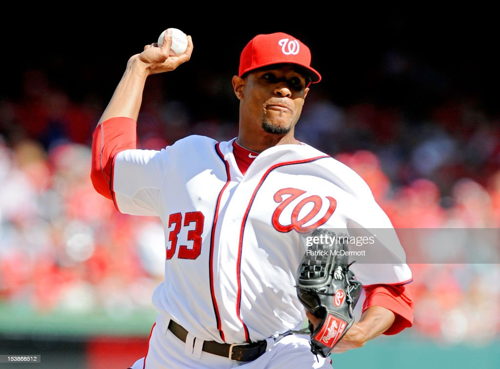 <a gi-track='captionPersonalityLinkClicked' href=/galleries/search?phrase=Edwin+Jackson&family=editorial&specificpeople=220506 ng-click='$event.stopPropagation()'>Edwin Jackson</a> #33 of the Washington Nationals pitches in the first inning against the St. Louis Cardinals during Game Three of the National League Division Series at Nationals Park on October 10, 2012 in Washington, DC.