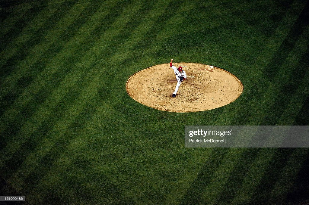 <a gi-track='captionPersonalityLinkClicked' href=/galleries/search?phrase=Edwin+Jackson&family=editorial&specificpeople=220506 ng-click='$event.stopPropagation()'>Edwin Jackson</a> #33 of the Washington Nationals throws a pitch against the St. Louis Cardinals during a game at Nationals Park on August 30, 2012 in Washington, DC.