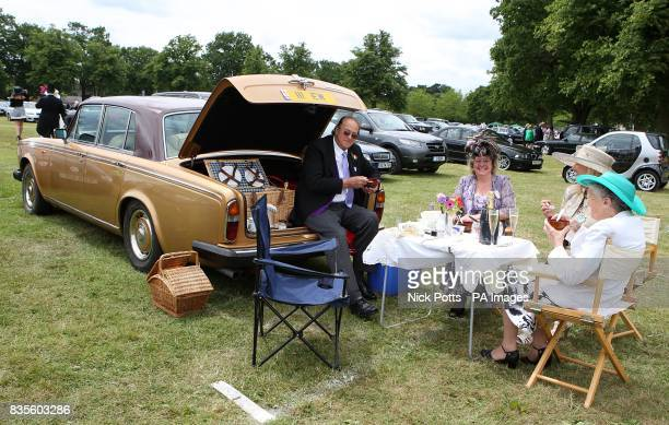 Edwin MolyneuxWebb enjoys a picnic out of the back of his car with friends on Ladies Day at Ascot Racecourse Berkshire