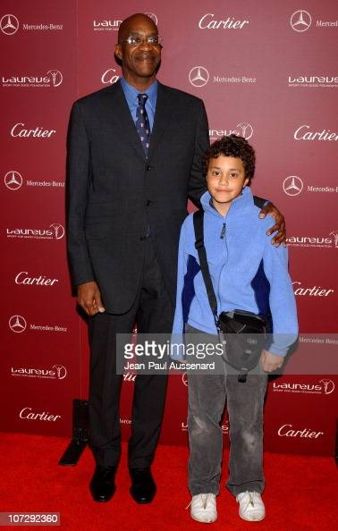 Edwin moses and son during a legend of the road meets the legends of