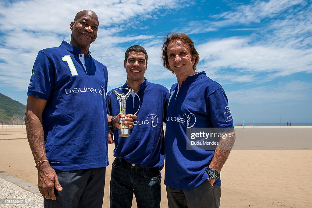 Edwin Moses, Brazilian Paralympic swimmer Daniel Dias, and Emerson Fittipaldi with the Laureus Statuette at Copacabana Beach on December 13, 2012 in Rio De Janeiro, Brazil. The Laureus World Sports Awards is recognised as the premier honours event in the international sporting calendar as stars of the sporting world come together to salute the finest sportsmen and sportswomen of the year.