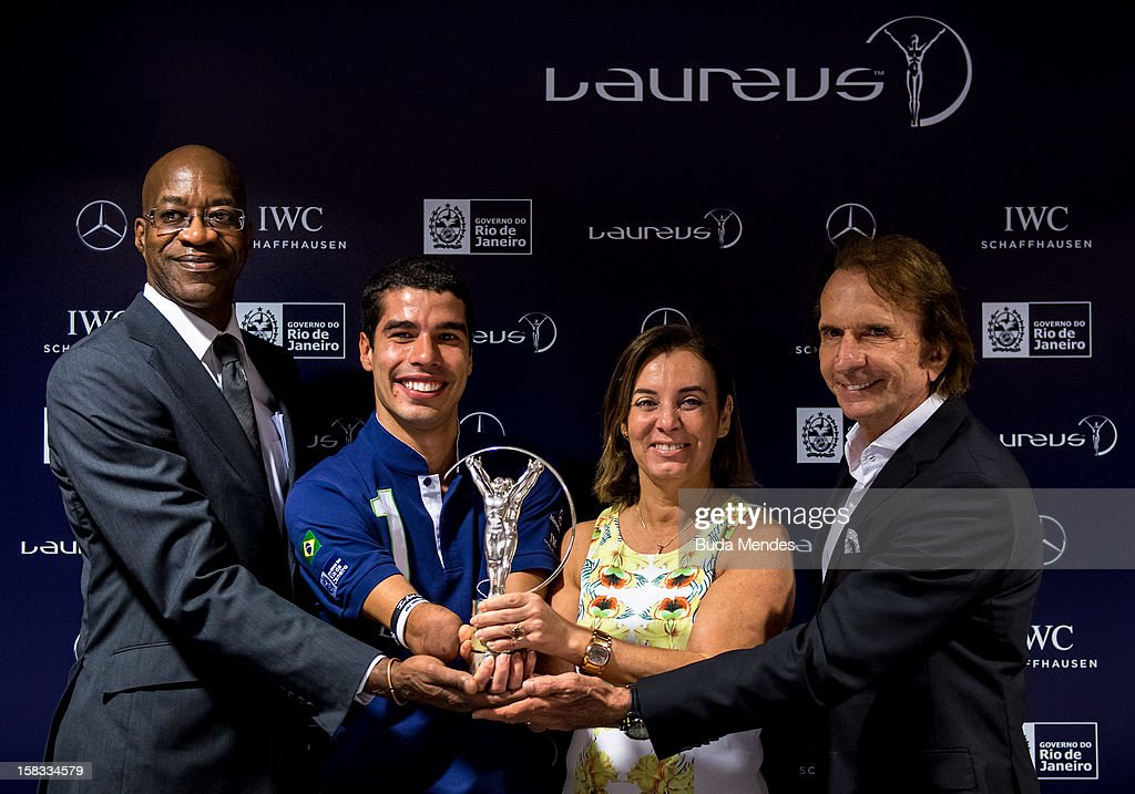 Edwin Moses, Brazilian Paralympic swimmer Daniel Dias, Sports Secretary of Rio de Janeiro Marcia Lins and Emerson Fittipaldi during a press conference to announce the Nominees for the 2012 Laureus World Sports Awards at Windsor Atlantica Hotel on December 13, 2012 in Rio De Janeiro, Brazil. The Laureus World Sports Awards is recognised as the premier honours event in the international sporting calendar as stars of the sporting world come together to salute the finest sportsmen and sportswomen of the year. (Photo by Buda Mendes/Getty Images For Laureus) Edwin Moses; Daniel Dias, Emerson Fitipaldi; Marcia Lins