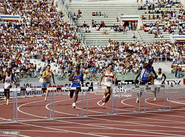 Edwin Moses of the United States clears the hurdle ahead of compatriot Danny Harris and Harald Schmid of West Germany during the Men's 400 metres...