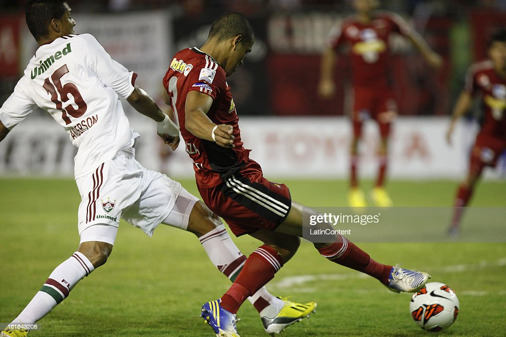 Edwin Peraza de Caracas FC fights for the ball with Anderson of Fluminense during a match between Caracas FC and Fluminense as part of the 2013 Copa Bridgestone Libertadores at the Olympic Stadium on February 13, 2013 in Caracas, Venezuela.
