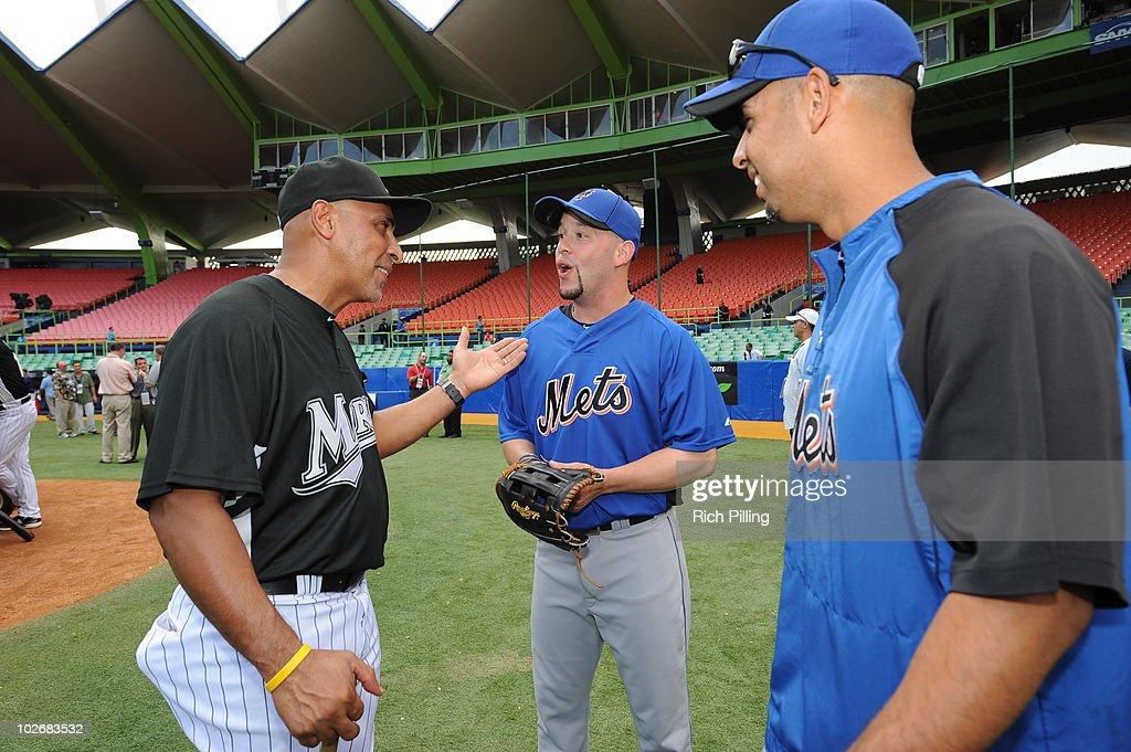 Edwin Rodriguez (left), manager of the Florida Marlins, speaks with <a gi-track='captionPersonalityLinkClicked' href=/galleries/search?phrase=Jesus+Feliciano&family=editorial&specificpeople=5710825 ng-click='$event.stopPropagation()'>Jesus Feliciano</a> (center) and <a gi-track='captionPersonalityLinkClicked' href=/galleries/search?phrase=Alex+Cora&family=editorial&specificpeople=206664 ng-click='$event.stopPropagation()'>Alex Cora</a> of the New York Mets prior to game one of the San Juan Series at Hiram Bithorn Stadium in San Juan, Puerto Rico on June 28, 2010. The Marlins defeated the Mets 10-3.
