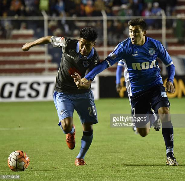 Edwin Saavedra of Bolivia's Bolivar vies for the ball with Marcos Acuña of Argentina Racing Club during their 2016 Copa Libertadores football match...