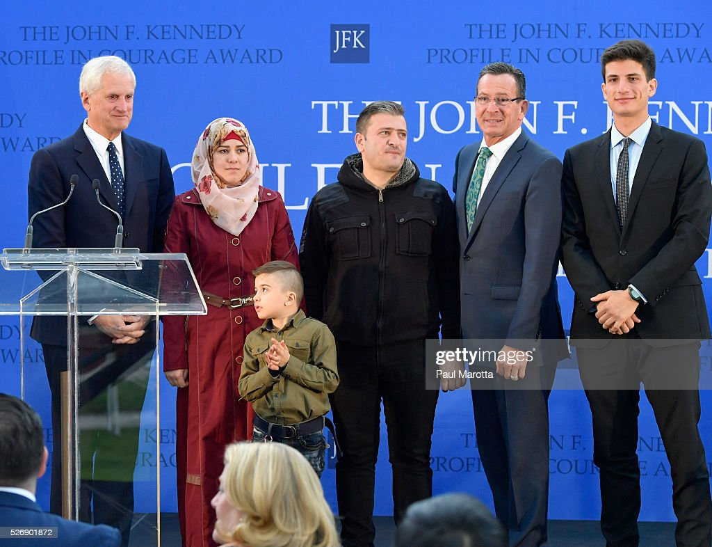 Edwin Schlossberg, Fatema, Ayham, Abdullah, Connecticut Governor Dannel Malloy (D) and Jack Schlossberg at the 2016 John F. Kennedy Profile in Courage Award at The John F. Kennedy Presidential Library And Museum on May 1, 2016 in Boston, Massachusetts. In 2015 following the Paris terrorist attacks, Governor Malloy defended the U.S. resettlement of Syrian refugees and personally welcomed a family of Syrian refugees to New Haven, Ct. after they had been turned away by the state of Indiana.