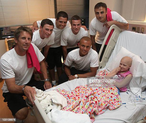 Edwin van der Sar Corry Evans Javier Hernandez Tom Cleverley Wes Brown and Dimitar Berbatov of Manchester United visit patients at the cancer unit at...