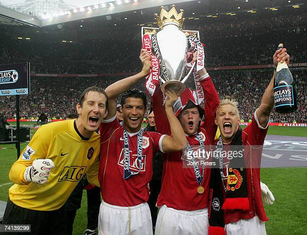 Edwin van der Sar Cristiano Ronaldo Wayne Rooney and Alan Smith of Manchester United celebrate winning the Barclays Premiership after the Barclays...