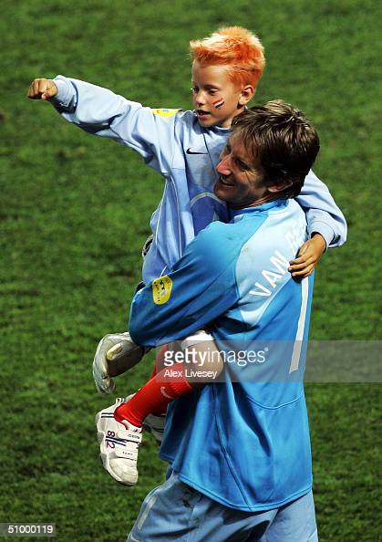 Edwin Van Der Sar of Holland along with his son celebrates victory over Sweden in the penalty shoot out during the UEFA Euro 2004 Quarter Final match...