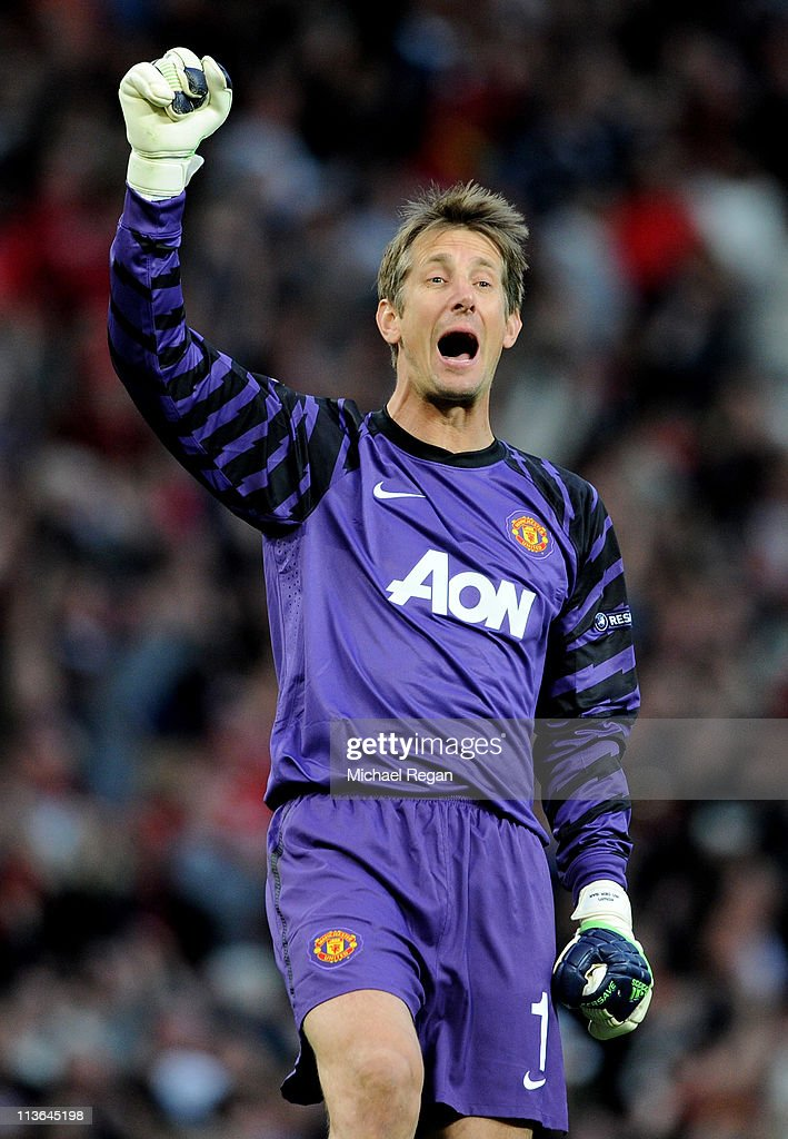 Edwin van der Sar of Manchester United celebrates after his team's second goal during the UEFA Champions League Semi Final second leg match between Manchester United and Schalke at Old Trafford on May 4, 2011 in Manchester, England.