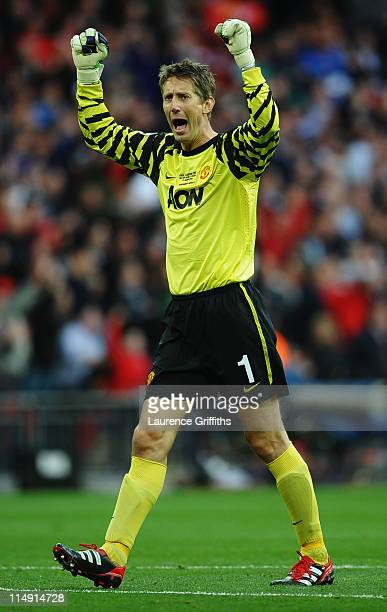 Edwin van der Sar of Manchester United celebrates as teammate Wayne Rooney scores the equalising goal during the UEFA Champions League final between...