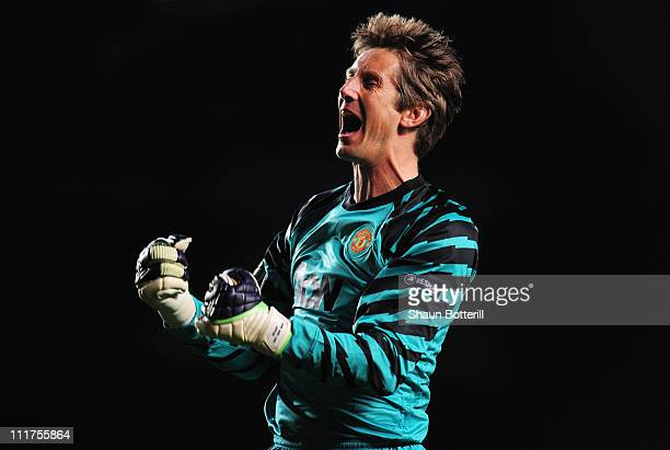 Edwin van der Sar of Manchester United celebrates as Wayne Rooney scores their first goal during the UEFA Champions League quarter final first leg...
