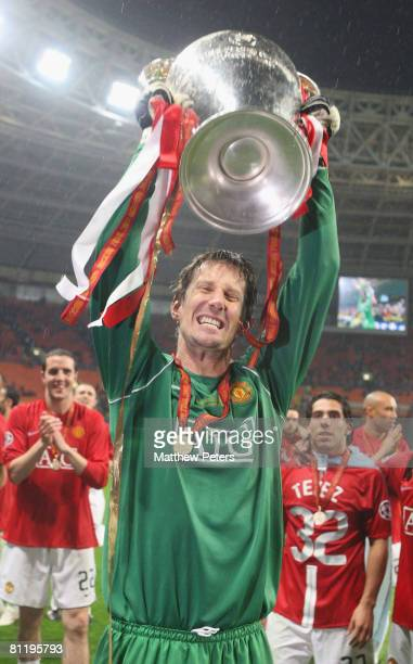 Edwin van der Sar of Manchester United celebrates with the trophy after winning the UEFA Champions League Final match between Manchester United and...