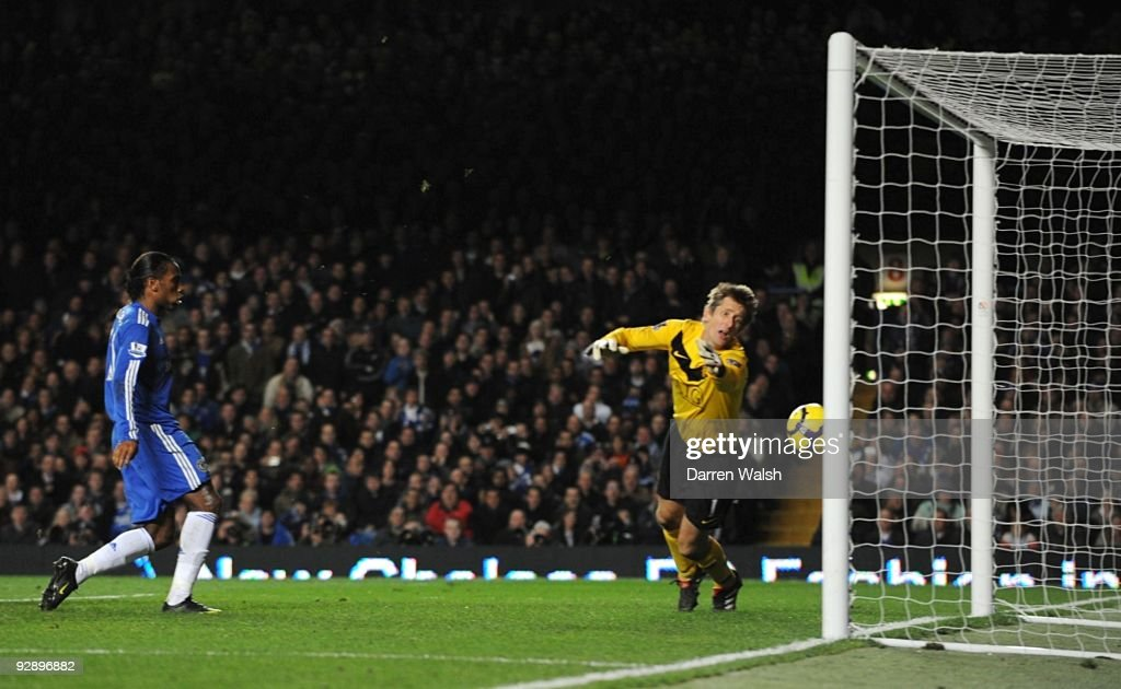 Edwin Van der Sar of Manchester United dives in vain as John Terry's header crosses the line during the Barclays Premier League match between Chelsea and Mancester United at Stamford Bridge on November 8, 2009 in London, England.