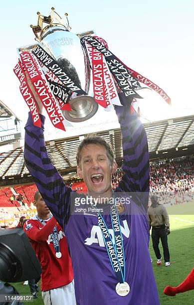 Edwin van der Sar of Manchester United lifts the Barclays Premier League trophy after the Barclays Premier League match between Manchester United and...