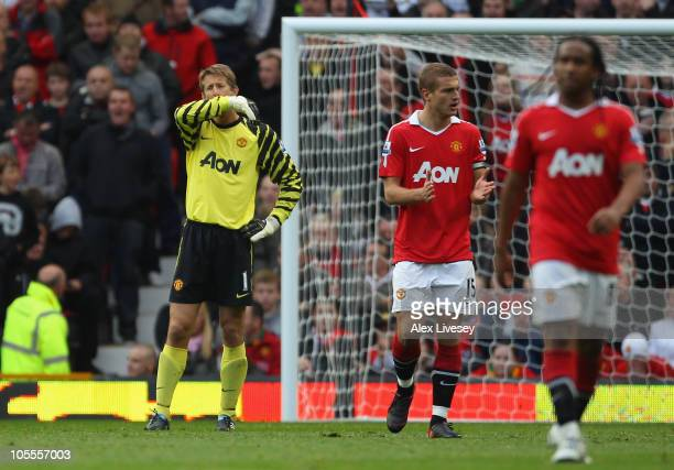 Edwin Van Der Sar of Manchester United looks dejected after his mistake led to the equalizing goal during the Barclays Premier League match between...