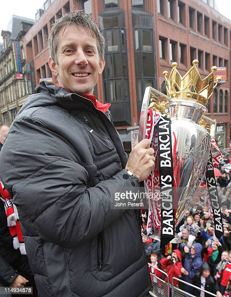 Edwin van der Sar of Manchester United poses with the Barclays Premier League trophy during the Manchester United Premier League Winners Parade on...