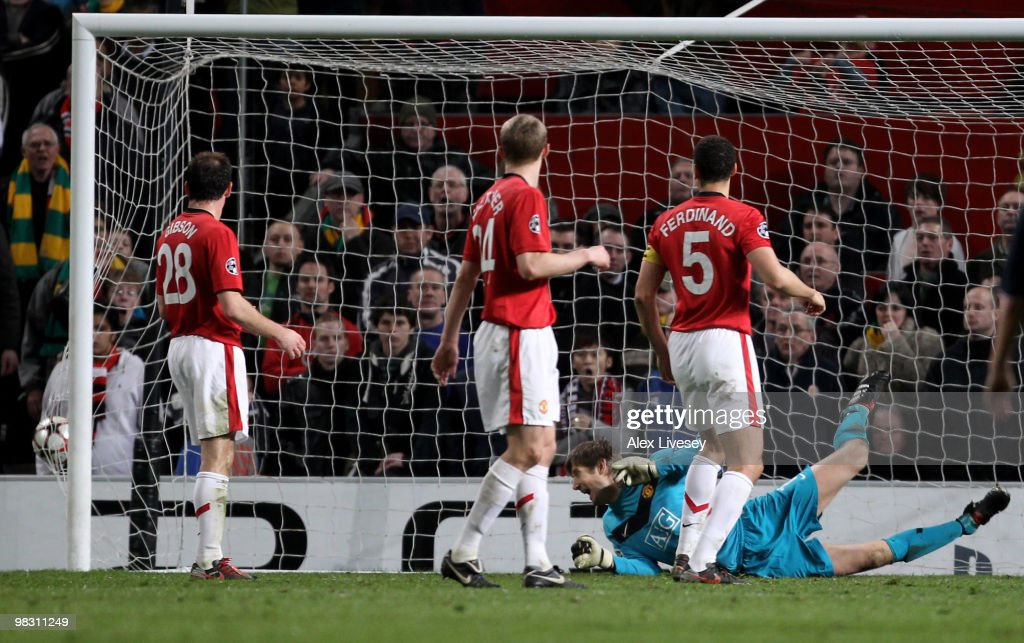 Edwin van der Sar of Manchester United watches the ball hit the back of the net as <a gi-track='captionPersonalityLinkClicked' href=/galleries/search?phrase=Arjen+Robben&family=editorial&specificpeople=194740 ng-click='$event.stopPropagation()'>Arjen Robben</a> of Bayern Muenchen scores his team's second goal during the UEFA Champions League Quarter Final second leg match between Manchester United and Bayern Muenchen at Old Trafford on April 7, 2010 in Manchester, England.