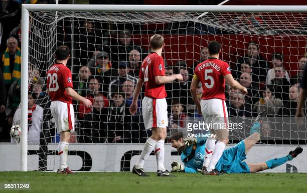 Edwin van der Sar of Manchester United watches the ball hit the back of the net as Arjen Robben of Bayern Muenchen scores his team's second goal...