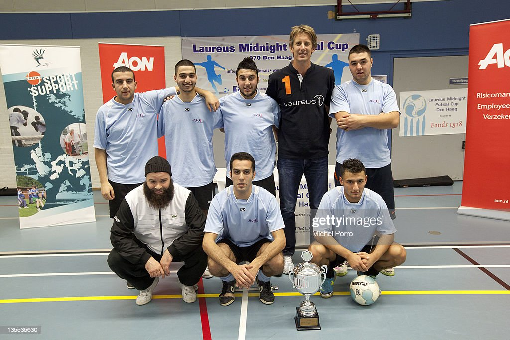Edwin van der Sar poses with teams after the award ceremony for the Laureus Midnight Futsal Cup on December 11, 2011 in The Hague, Netherlands.