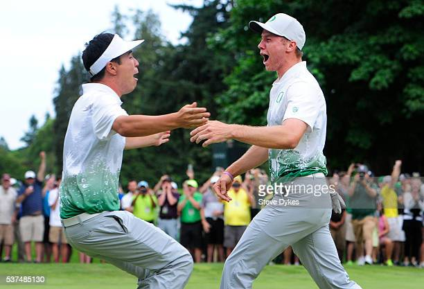 Edwin Yi and Sulman Raza of Oregon celebrate after winning the 2016 NCAA Division I Men's Golf Championship at Eugene Country Club on June 1 2016 in...