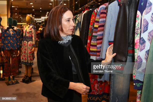 Edwina McCann looks at garments at Gucci boutique during Vogue American Express Fashion's Night Out 2017 on September 7 2017 in Sydney Australia