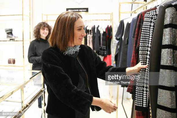 Edwina McCann looks at garments at Harolds boutique during Vogue American Express Fashion's Night Out 2017 on September 7 2017 in Sydney Australia