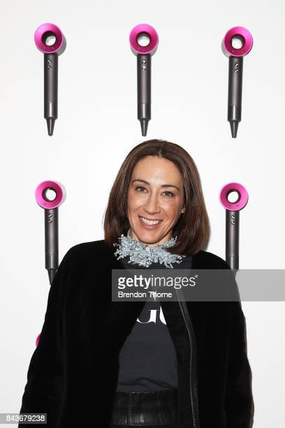 Edwina McCann poses at the Dyson blow dry bar during Vogue American Express Fashion's Night Out 2017 on September 7 2017 in Sydney Australia
