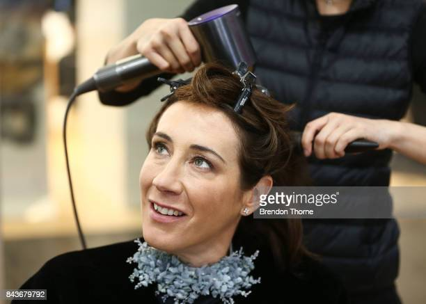 Edwina McCann receives a blow dry at the Dyson blow dry bar during Vogue American Express Fashion's Night Out 2017 on September 7 2017 in Sydney...