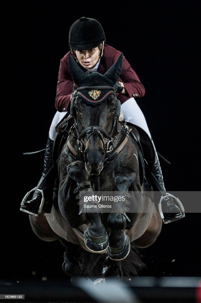 Edwina Tops-Alexander of Australia rides Guccio at the Longines Grand Prix during the Longines Hong Kong Masters International Show Jumping at Asia World Expo on March 2, 2013 in Hong Kong, Hong Kong.