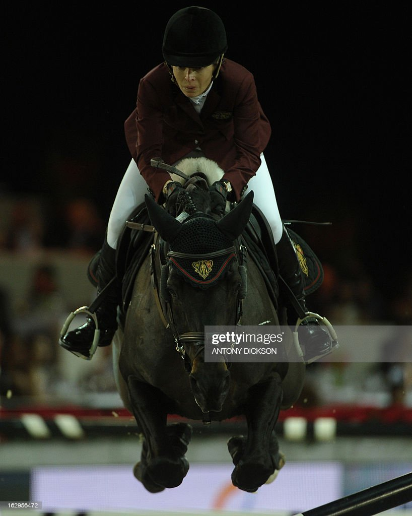 Edwina Tops-Alexander of Australia riding Guccio knocks off a post as they compete in the international jumping competition Grand Prix equestrian event in Hong Kong on March 2, 2013. AFP PHOTO / Antony DICKSON