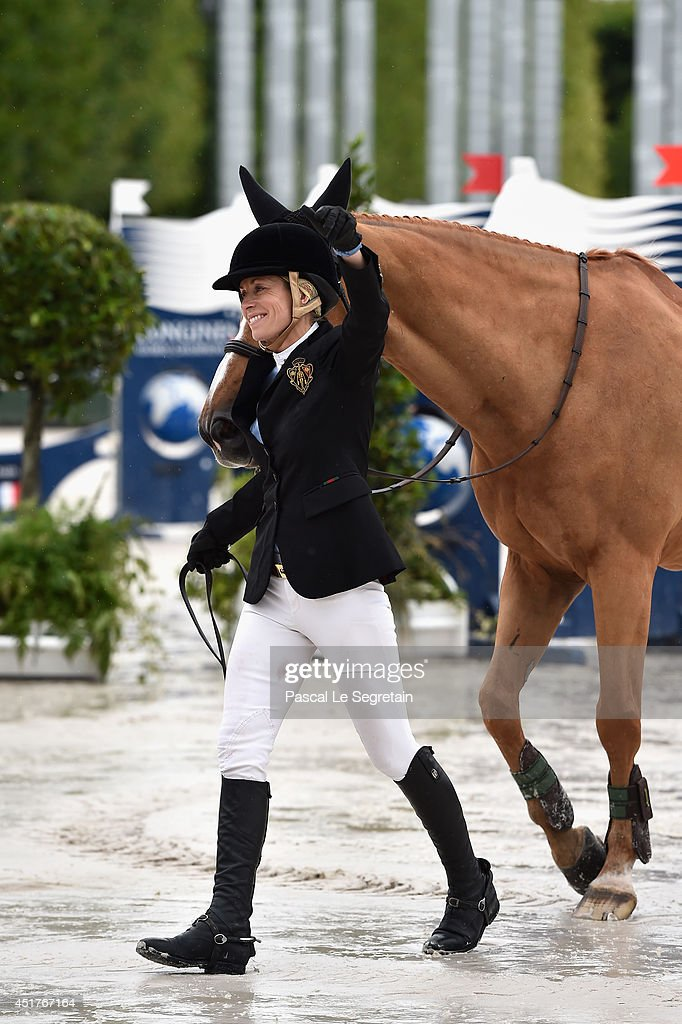 <a gi-track='captionPersonalityLinkClicked' href=/galleries/search?phrase=Edwina+Tops-Alexander&family=editorial&specificpeople=8673928 ng-click='$event.stopPropagation()'>Edwina Tops-Alexander</a> poses with the horse Itot du Chateau during the Paris Eiffel Jumping presented by Gucci at Champ-de-Mars on July 6, 2014 in Paris, France.