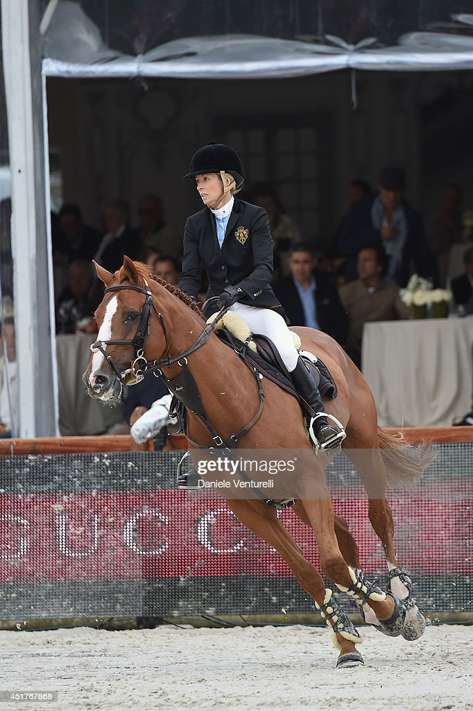 Edwina Tops-Alexander rides Old Chap Tame during the ' Gucci Gold Cup Paris Eiffel Jumping Table A against the clock with jump-off ' at the Paris Eiffel Jumping presented by Gucci at Champ-de-Mars on July 6, 2014 in Paris, France.