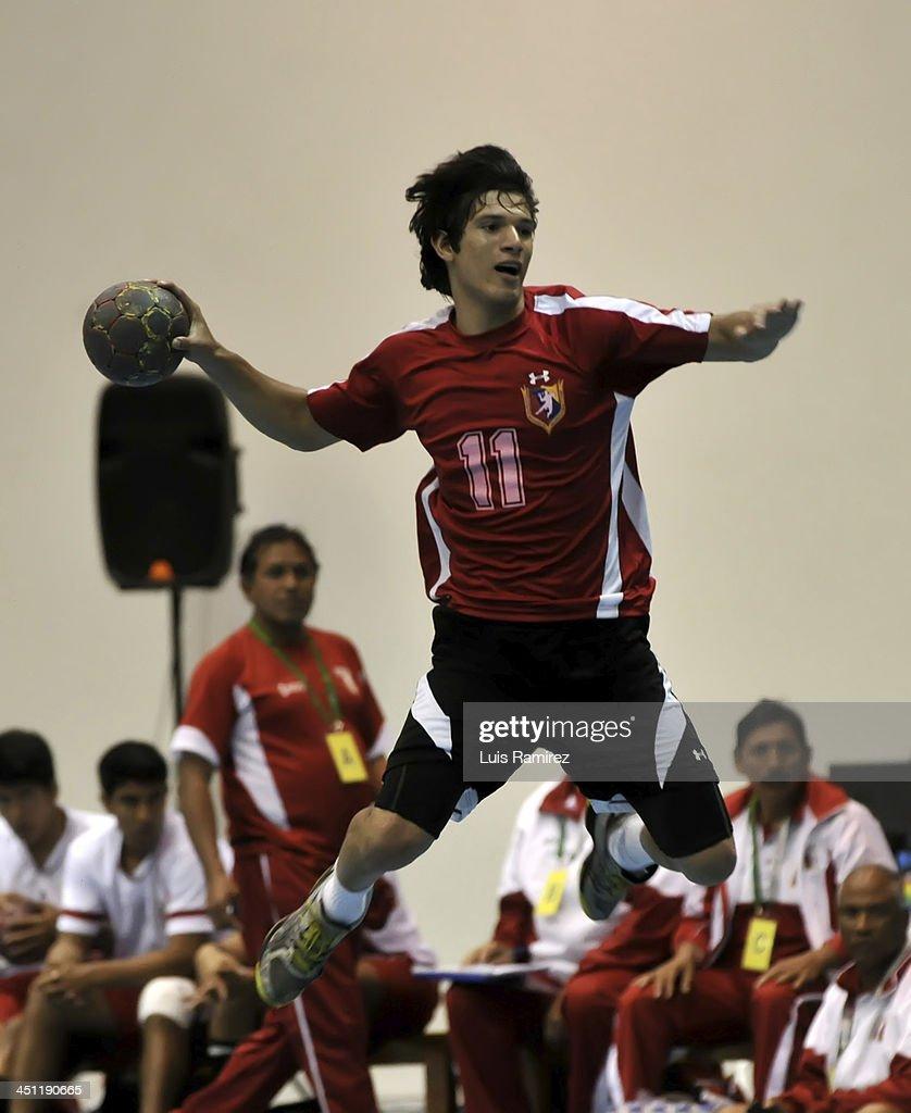 Edwuard Suarez of Venezuela in action during a handball match between Peru and Venezuela as part of the XVII Bolivarian Games Trujillo 2013 at Coliseo Colegio San Agustin on November 21, 2013 in Chiclayo, Peru.