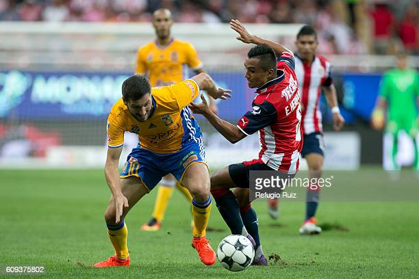 Edwuin Hernandez of Chivas fights for the ball with AndrePierre Gignac of Tigres during the 10th round match between Chivas and Tigres as part of the...